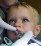 Baby on dental examination Royalty Free Stock Image