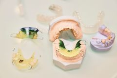 Baby dentures close up view from above on a light background stock photography