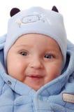 Baby in der blauen Kleidung Stockfotos