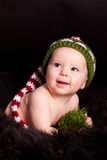 Baby in der Strickmütze Stockfotografie