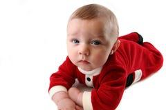 Baby in der Weihnachtsmann-Ausstattung Stockfotografie
