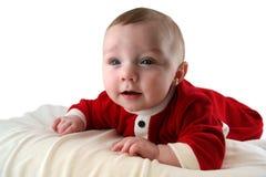 Baby in der Weihnachtsmann-Ausstattung Stockbild