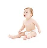 Baby in der Windel mit Zahnbürste Lizenzfreie Stockbilder