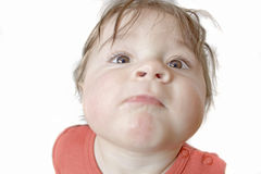 Baby with determined expression Royalty Free Stock Image