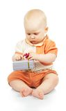 Baby develops colorful gift box Stock Photography