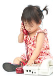 Baby dialing old beige phone calling mom Royalty Free Stock Photo