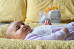 Baby with diaper. Baby on the changing table with diaper Royalty Free Stock Image