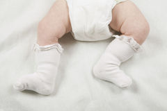 Baby In Diaper And Socks Stock Image