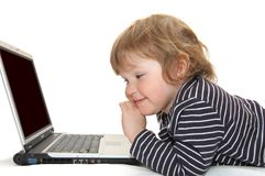 Baby in Diaper Typing on Computer Royalty Free Stock Images