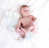 Baby in diaper on a white background Stock Image