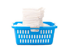 Baby diapers in a blue laundy basket Royalty Free Stock Photo
