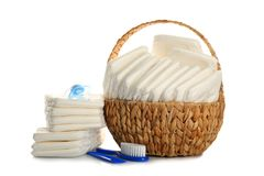 Free Baby Diapers In Wicker Basket And Necessities Stock Image - 105535481