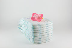 Baby diapers on a white background Stock Images