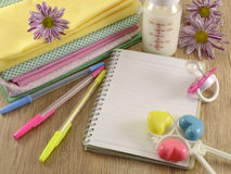 Baby Diary With Clothing Stock Image