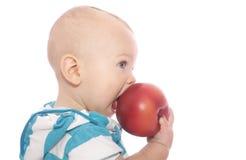Baby die Appel eet Royalty-vrije Stock Afbeelding