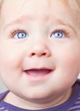 Baby die omhoog kijkt Stock Afbeeldingen