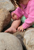 Baby Digging in the Sand. Toddler playing at the beach royalty free stock image