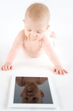 Baby with digital tablet Stock Photos