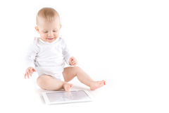 Baby with digital tablet. On white Stock Image