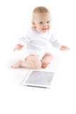 Baby with digital tablet Stock Photography