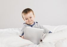 Baby with digital tablet Royalty Free Stock Photo