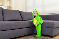 Baby with dinosaur dressing Royalty Free Stock Images