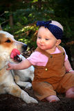 Baby in Dirt with Dog Stock Image