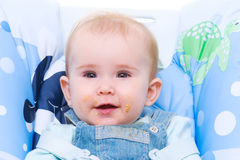 Baby with dirty mouth after cookie Royalty Free Stock Image