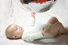 Baby and disco ball. Six month old baby in shadow of disco ball Royalty Free Stock Image