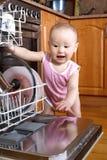 Baby at dishwasher Stock Image