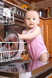 Baby at dishwasher Royalty Free Stock Images