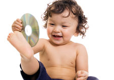 Baby with disk. Baby playing with disk,isolated on a white background Royalty Free Stock Photography