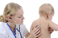 Baby and doctor Royalty Free Stock Images