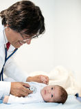 Baby at the doctor Stock Photography