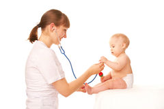 Baby and doctor. Stock Photo