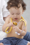 Baby at the doctor. Royalty Free Stock Photos