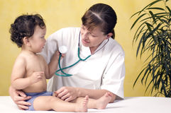Baby with doctor. Royalty Free Stock Image