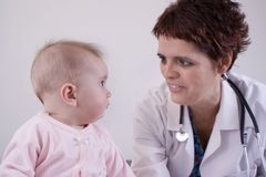Baby with doctor royalty free stock photo