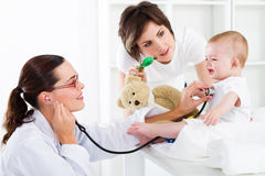 baby doctor and mother Royalty Free Stock Image
