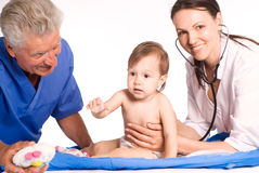 Baby and doctors Royalty Free Stock Images
