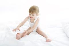 Baby doing gymnastics stock image