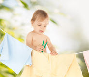 Baby doing laundry Stock Photos
