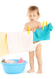 Baby doing laundry Royalty Free Stock Photography