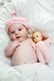 Baby Doll. Photo of a cute baby girl with her doll stock images