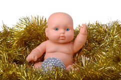 Baby doll angel boy sitting with christmas ball Royalty Free Stock Photography