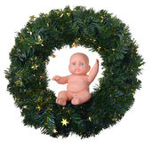 Baby doll angel boy sitting on christmas wreath. Baby doll  angel boy sitting on christmas wreath isolated on white Stock Images