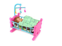 Baby Doll in Bed Royalty Free Stock Photos