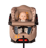 Baby doll in a booster seat for a car Stock Image