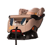Baby doll in a booster seat for a car Royalty Free Stock Photography