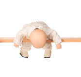 Baby doll on a crossbar Royalty Free Stock Images